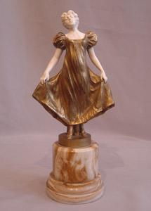 Art Deco bronze and ivory of a young girl signed A.M.Wolff fec.