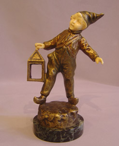 Art Deco Bronze and ivory of boy with lantern.