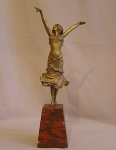 Art Deco Paul Philippe bronze figure on rouge marble base.