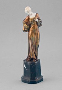 Art Deco ivory and gilt bronze statuette of lady on shaped marble base.