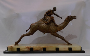 Art deco bronze of a racing camel with Nubian jockey.