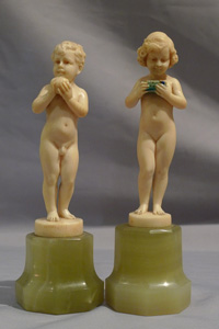 Preiss, Fritz Ferdinand a pair of Art Deco ivory statuettes of young boy and girl.