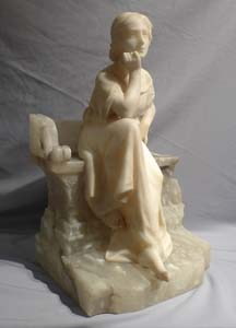 Antique Italian alabaster study of a seated girl.