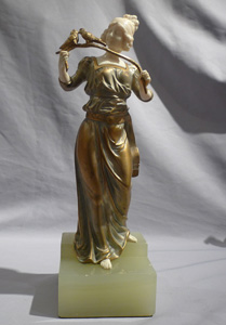 Art deco bronze and ivory by George Omerph of maiden holding a branch with birds.