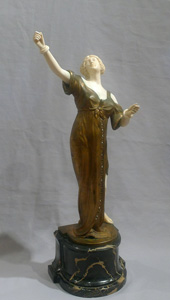 Bronze and ivory Art Deco figure of a dancer on antique vert marble base.