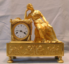 French Empire clock by Reiche of woman reading