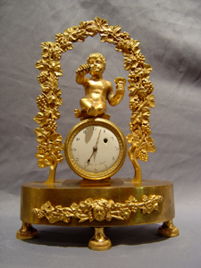 Antique French Empire clock celebrating viticulture