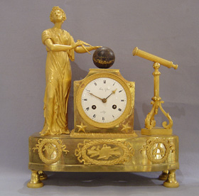 Antique French Empire ormolu mantel clock representing Astronomy.