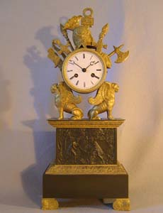 Antique French Charles X clock with trophies of war.