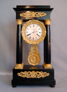 French antique Louis Phillipe ebony and ormolu mounted portico clock.