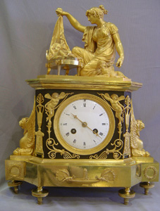 French Empire clock of Venus uncovering Cupid.