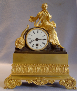 Antique Clock, French Charles X period in ormolu and patinated bronze of Hope, signed Leroy a Paris.