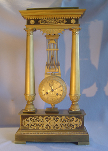 Antique French Mystery portico clock with pinwheel escapement movement in pendulum after Breguet.