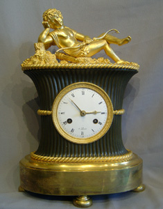 French antique Empire clock in ormolu and patinated bronze of Amor asleep.