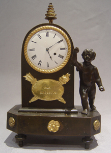 English Regency antique miniature mantel clock in patinated bronze and ormolu.