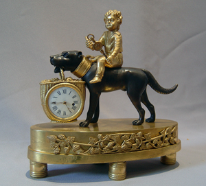 Whimsical French Empire small size dog clock with child.