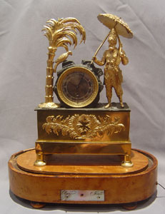 Antique French Robinson Crusoe mantel clock with musical base.