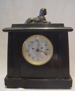 English late Regency Derbyshire black marble double fusee mantle clock in Egyptian style by Yonge.
