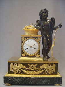 French Empire antique clock by Ledieur in marble, patinated bronze and ormolu.