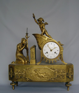 Antique French Empire ormolu clock of the