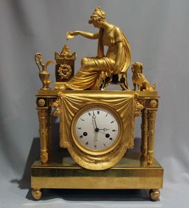 Antique French Empire clock of woman at altar of love