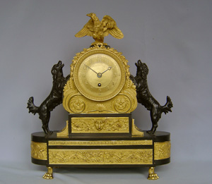 Antique English Regency mantel or library clock in patinated bronze and ormolu.