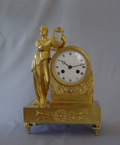 French Empire antique clock in ormolu of Apollo's Muse.