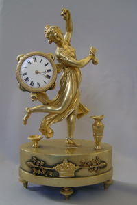 Antique mantel clock French Empire classic model of dancing bacchante.