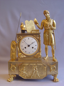 French Empire mantel clock in ormolu of classical figure.