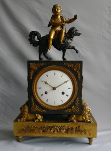 French Directoire or Empire clock with cupid riding a dog.