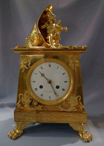 Antique Empire clock in ormolu signed Bergmiller and having military Trophies.