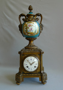 Antique urn clock of porcelain and ormolu signed Balthazar.