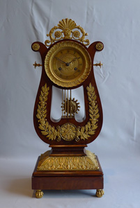 French antique Charles X period lyre clock in mahogany and ormolu.