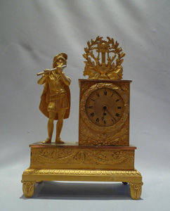 French Empire antique ormolu miniature mantel clock signed Romilly.