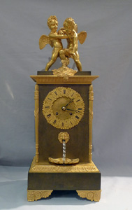 Antique French double automaton clock with two children fighting over a butterfly & water feature.