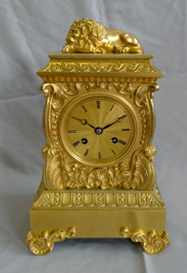 Antique ormolu French mantel clock surmounted by Lion.