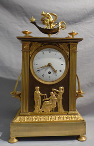 French Empire ormolu antique mantel clock of neo-classical design.