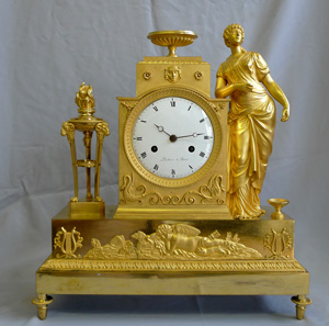 Antique French Empire mantel clock in ormolu signed Lachere.