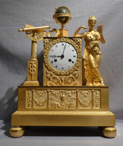 French Empire antique ormolu mantel clock of Astronomy signed Cartier.