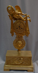 Antique French 19th century mantel clock of Cupid floating over clouds.
