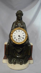 Antique English Regency mantel clock of Cybele sitting on her throne.