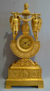 Antique French Charles X ormolu lyre clock with remote pendulum, attributed to Thomire, dated 1824.