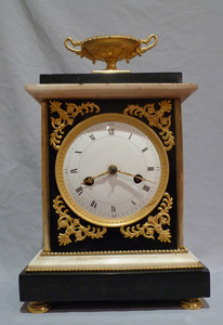 Antique French Directoire marble and ormolu mantel clock.