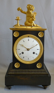 Antique French Directoire period ormolu and patinated bronze mantel clock signed Maniere a Paris.