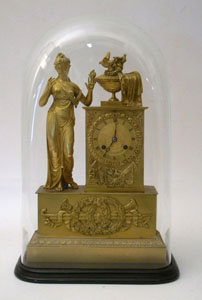 Antique French Empire clock of woman standing.