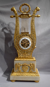 Antique French Charles X ormolu and alabaster lyre clock.