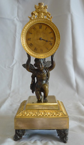 Antique English Regency timepiece supported by Cupid.