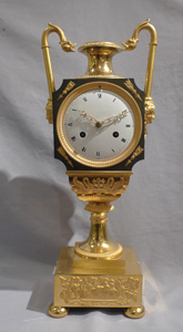 Antique French Empire vase shaped mantel clock in ormolu and patinated bronze