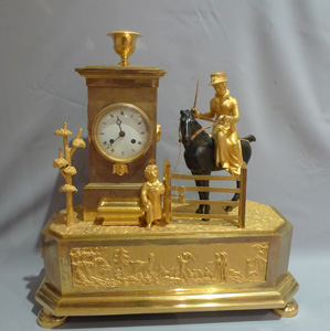 Antique French Empire Genre mantel clock of an Arcadian hunting scene.