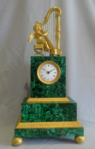Antique Russian malachite and gilt bronze mantel clock.